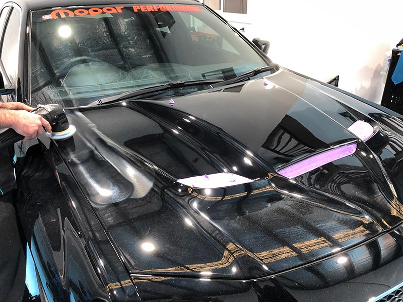 Detailer performing paint correction